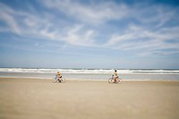 Women Biking on Beach