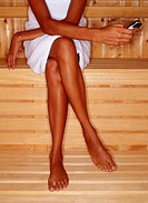 Woman Using Cell Phone in Sauna