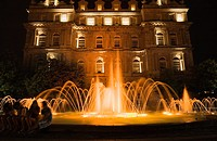 Water fountain illuminated at dusk, Place Vauquelin, Old Montreal, Quebec, Canada