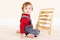 Young Boy Playing with Picture Blocks