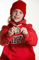 Girl Holding Hockey Medal