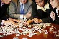Businesspeople Putting Together Jigsaw Puzzle