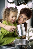 Mother and Daughter Sifting Flour