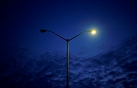 Streetlight with one lamp out at dawn Brampton, Ontario
