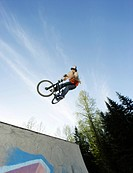 BMX Biker Jumping on Halfpipe