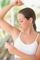 Woman Using Deodorant