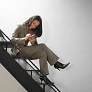 Businesswoman on Staircase