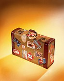 Suitcase with Stickers from Various Travels