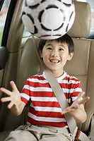 Child Sitting in Automobile