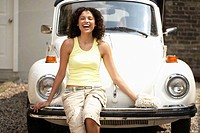 Woman Sitting on Car Bumper