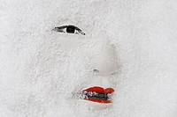 traditional but broken japanese noh theatre mask of ko-omote representing young beauty woman in snow - symbolism of growing older dead slowly but sure...