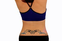 Female Lower Back with a Tattoo