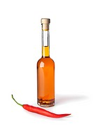 Chili pepper oil on white background
