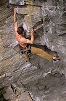 Climber ascends Bladerunner, Skaha Bluffs, Penticton, British Columbia, Canada.