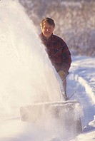 Man using snowblower, Smithers, British Columbia, Canada.