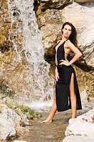 brunette in waterfall