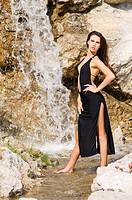 brunette in waterfall