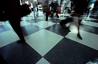 Travellers Walking Through Airport