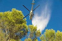 Spain, Balearic Islands, Mallorca, Helicopter stifling wildfire