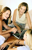 Three Women with Laptop Talking