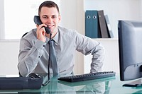 Businessman getting good news on the phone