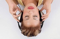 laying woman with headphone