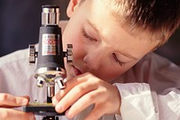Boy Adjusting Microscope