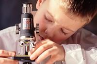Boy Adjusting Microscope