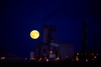 Full moon rising behind Saskferco plant in Saskatchewan
