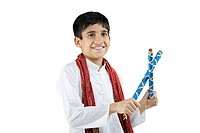 Boy with dandiya sticks