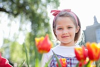 Girl standing in field of flowers (thumbnail)