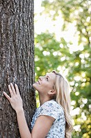 Woman hugging tree outdoors
