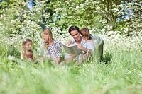 Family relaxing together in grass
