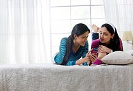Girls looking at an sms on a mobile phone