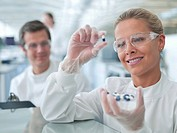 Scientist examining pills in lab