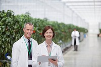 Scientists using clipboard in greenhouse