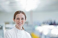 Scientist smiling in lab