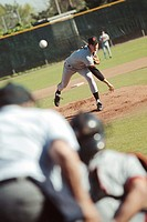 Baseball Player Pitching Ball to Catcher