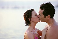 Couple Kissing at Ocean