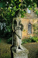 A garden statue of a young woman at a hunting lodge in Hampshire in England.