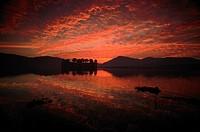 Lake and Jal Mahal Palace at Sunrise