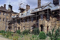 Scaffolding wraps a building during the restoration of Crathorne Hall in North Yorkshire, England. The grand manor house serves as an elegant hotel.