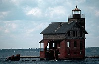 An abandoned lighthouse on the Patuxent River is endangered by rising water and erosion along the shore of Chesapeake Bay.