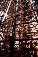 Bete Emanuel, a 900_year_old church, is covered by a scaffolding supporting its roof which prevents further leaking into the structure.