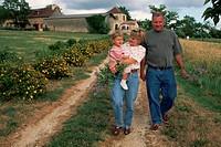 Truscott Family Walking Down a Road