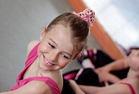Ballet girl with friends during ballet lesson
