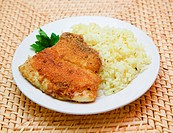 fried breaded tilapia served with rice and herbs