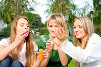 girls inflating soap_bubbles