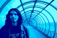 long_haired men in blue tunnel