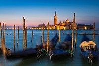 Sunrise over San Giorgio Maggiore with gondolas in the foreground, Venice, Italy, Europe
